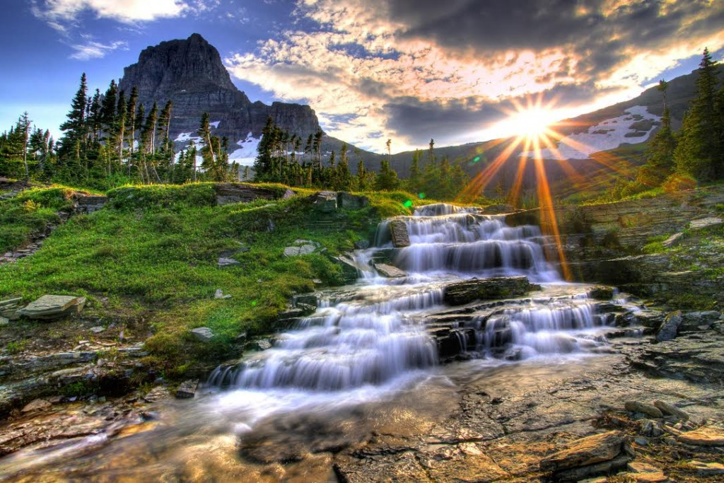 Mountain and waterfall at Logan Pass at sunset in Glacier National Park Montana.