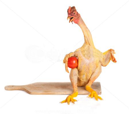 stock-photo-raw-full-length-chicken-standing-on-cutting-board-and-holding-tomato-47000686